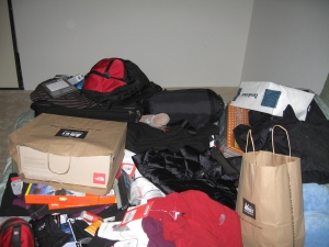 My guest room became a mini REI. Enough stuff to cover a queen bed - no wonder it didn't fit in my suitcase!