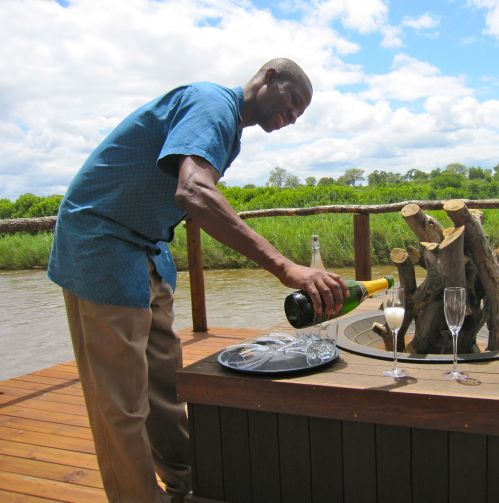 Reineck pouring champagne for our toast to Lion Sands