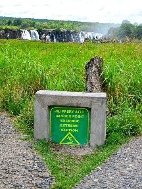 Vic Falls Warning Sign and People